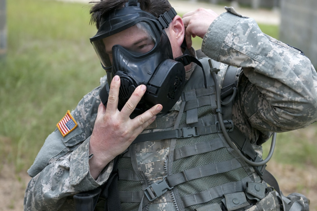 Sgt. Curtis Presley, a bandsman representing the 99 Reserve Support Command, checks his gas mask during the combat skills testing event at the 2017 U.S. Army Reserve Best Warrior Competition at Fort Bragg, N.C. June 14, 2017. This year's Best Warrior Competition will determine the top noncommissioned officer and junior enlisted Soldier who will represent the U.S. Army Reserve in the Department of the Army Best Warrior Competition later this year at Fort A.P. Hill, Va. (U.S. Army Reserve photo by Sgt. Jennifer Shick) (Released)