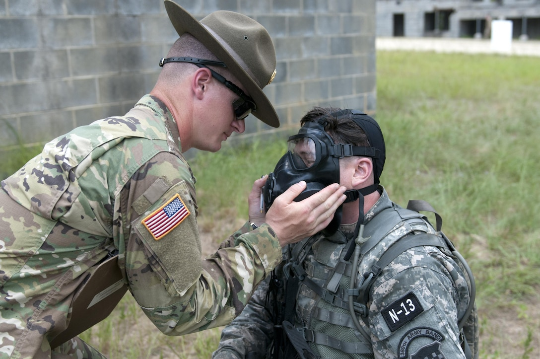 Sgt. Curtis Presley, a bandsman representing the 99 Reserve Support Command, has his gas mask checked by range cadre during the combat skills testing event at the 2017 U.S. Army Reserve Best Warrior Competition at Fort Bragg, N.C. June 14. This year's Best Warrior Competition will determine the top noncommissioned officer and junior enlisted Soldier who will represent the U.S. Army Reserve in the Department of the Army Best Warrior Competition later this year at Fort A.P. Hill, Va. (U.S. Army Reserve photo by Sgt. Jennifer Shick) (Released)