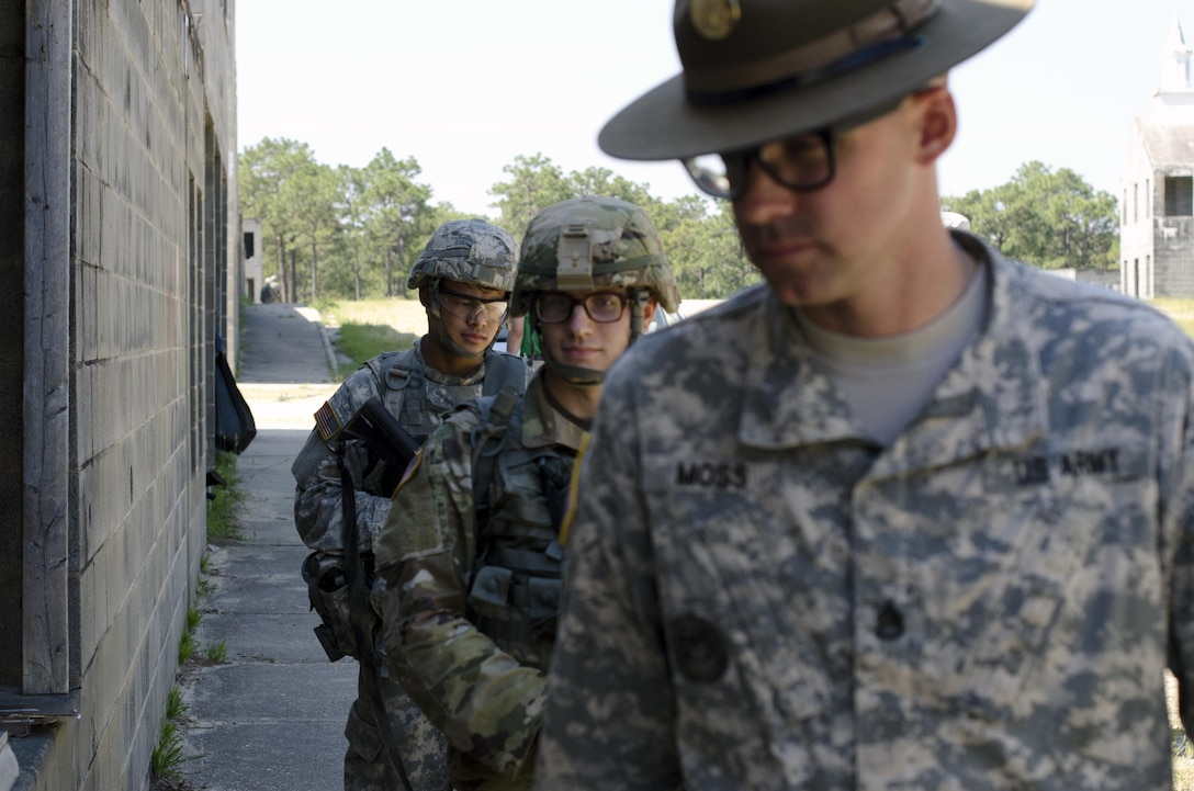 A drill sergeant leads two Warriors to a mission brief during the Combat Skills Testing Lanes at the 2017 U.S. Army Reserve Best Warrior Competition at Fort Bragg, N.C. June 14. This year's Best Warrior Competition will determine the top noncommissioned officer and junior enlisted Soldier who will represent the U.S. Army Reserve in the Department of the Army Best Warrior Competition later this year at Fort A.P. Hill, Va. (U.S. Army Reserve photo by Sgt. William A. Parsons) (Released)