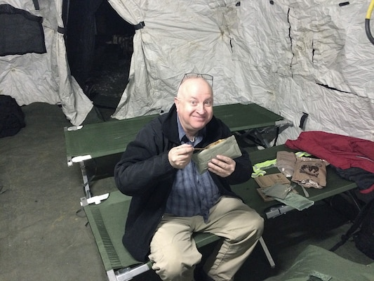 Black Team member Craig Hill enjoys a Meal, Ready-to-Eat during Turbo Distribution 16-2.