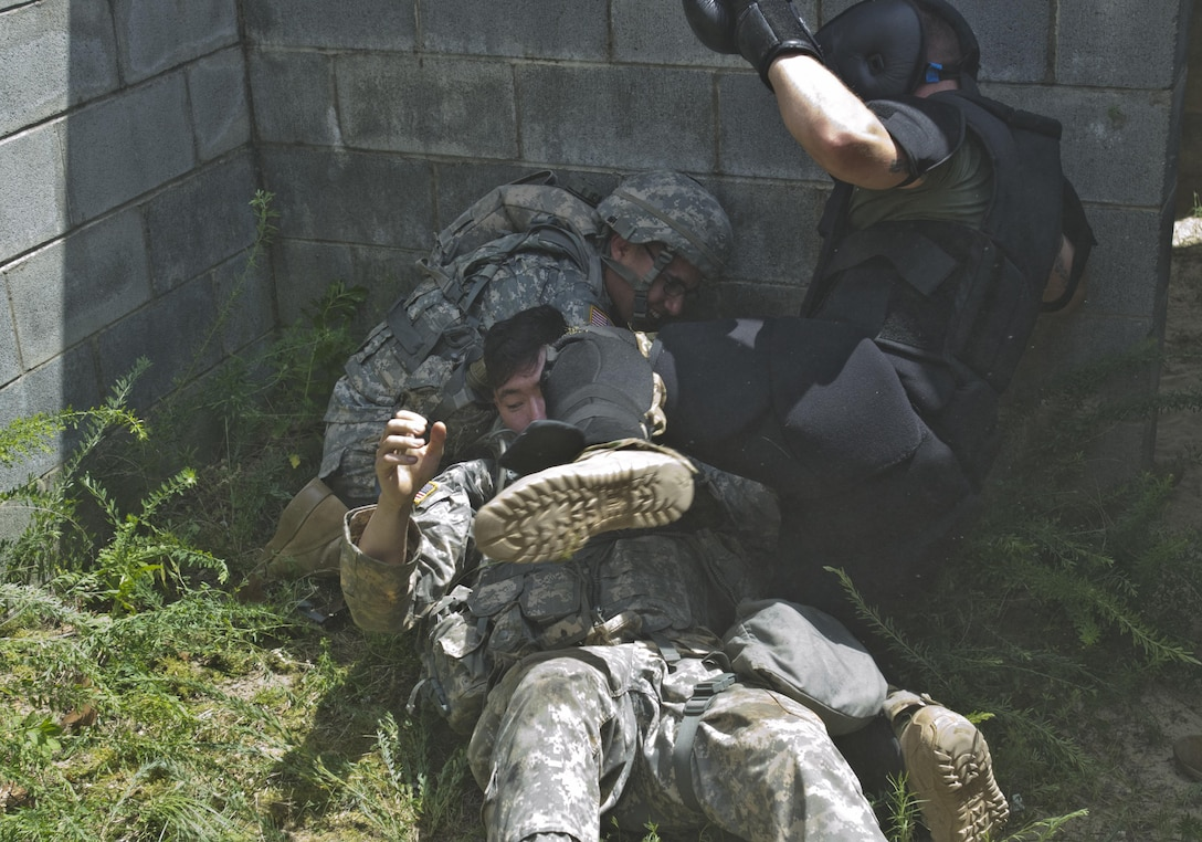 Spc. Wantae Seong, a carpentry and masonry specialist representing 412th Theater Engineer Command takes a knee to the face from an instructor at the XVIII Airborne Corps Combatives School during the Combat Skills Testing Lanes at the 2017 U.S. Army Reserve Best Warrior Competition at Fort Bragg, N.C. June 14. This year's Best Warrior Competition will determine the top noncommissioned officer and junior enlisted Soldier who will represent the U.S. Army Reserve in the Department of the Army Best Warrior Competition later this year at Fort A.P. Hill, Va. (U.S. Army Reserve photo by Sgt. William A. Parsons) (Released)