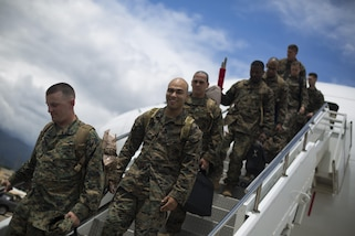 Marines with Special Purpose Marine Air-Ground Task Force - Southern Command exit a Boeing 767 charter aircraft after landing at Soto Cano Air Base, Honduras, June 1, 2017. The main body of SPMAGTF-SC arrived in Honduras to begin their six-month deployment in Central America. The task force, comprised of approximately 300 Marines from both active and reserve components, will operate in Belize, El Salvador, Guatemala and Honduras from June to November to conduct engineering projects and build upon security cooperation efforts and established relationships in the region. (U.S. Marine Corps photo by Sgt. Ian Leones)