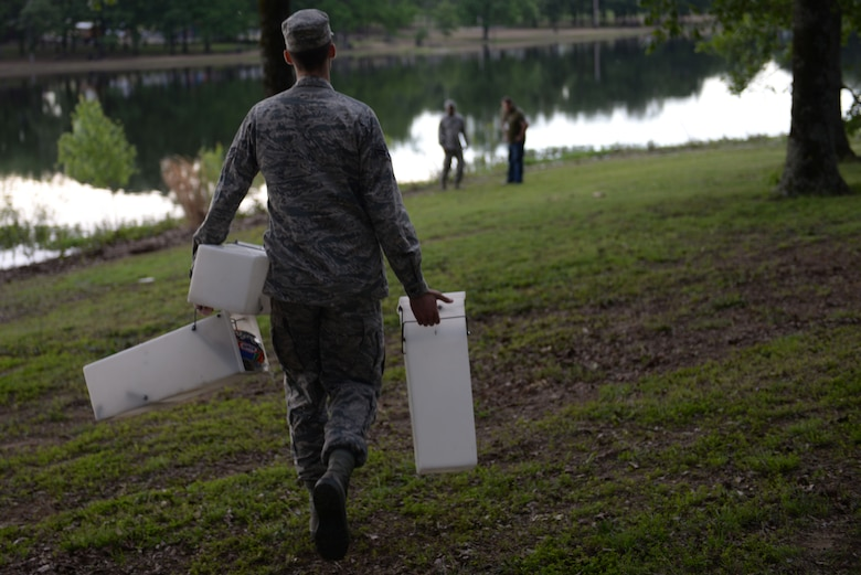 Airman 1st Class Alexander Smith, 19th Civil Engineering Squadron pest management technician, brings live-capture traps to the edge of the Little Rock Air Force Base lake May 3, 2017. Animals tend to hide by walking along the edges of the lake. (U.S. Air Force photo by Airman Rhett Isbell)