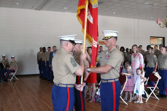 Major Jason G. Ellis, commanding officer of Recruiting Station Columbia (RS COL), hands the colors to Sgt. Maj. Daniel D. Moore, sergeant major of RS COL, after taking command during the change of command ceremony at Fort Jackson, Columbia, South Carolina, on June 14, 2017. Ellis is returned for his second tour of recruiting duty. (Marine Corps photo by Sgt. Tabitha Bartley)