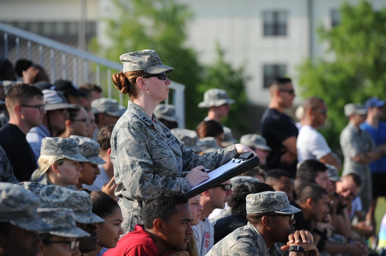 "Capt. Danielle Shipman, 336th Training Squadron instructor, serves as a judge during the 81st Training Group drill down at the Levitow Training Support Facility drill pad June 16, 2017, on Keesler Air Force Base, Miss. Airmen from the 81st TRG competed in a quarterly open ranks inspection, regulation drill routine and freestyle drill routine. The 334th TRS ""Gators"" took first place this quarter. (U.S. Air Force photo by Kemberly Groue)"