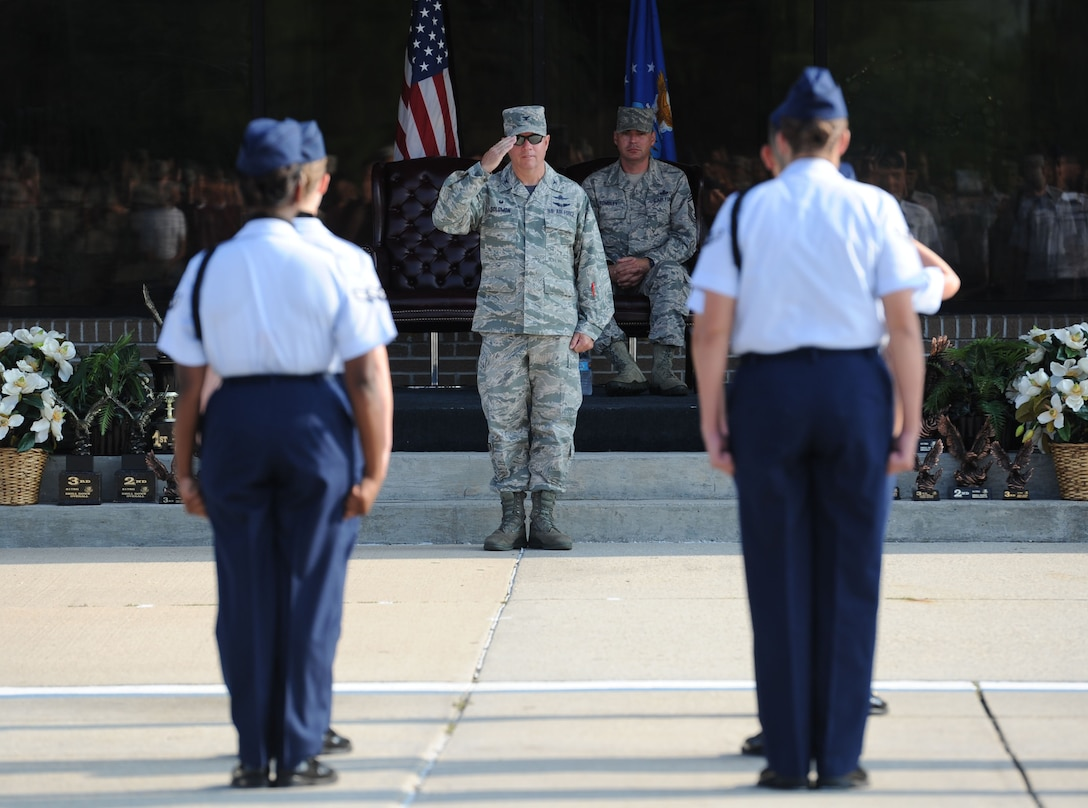 "Col. Scott Solomon, 81st Training Group commander, salutes the 335th Training Squadron regulation drill team before their performance during the 81st TRG drill down on the Levitow Training Support Facility drill pad June 16, 2017, on Keesler Air Force Base, Miss. Airmen from the 81st TRG competed in a quarterly open ranks inspection, regulation drill routine and freestyle drill routine. The 334th TRS ""Gators"" took first place this quarter. (U.S. Air Force photo by Kemberly Groue)"