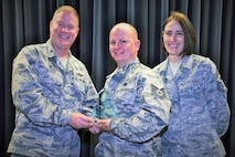 Tech. Sgt. Travis Whitton, 302nd Maintenance Squadron, receives the 302nd Airlift Wing's 2017 1st Quarter award in the NCO category from Col. James DeVere, 302nd Airlift Wing commander, and Chief Master Sgt. Vicki Robertson, 302nd AW command chief, during a ceremony at Peterson Air Force Base, Colo., June 4, 2017. As part of the Reserve wing's quarterly awards program, Citizen Airmen are nominated for excellence in leadership, job performance, significant self-improvement and contributions to their on and off-base communities. The other 2017 First Quarter Award winners are: Airman 1st Class Kwesi Hanson, 302nd Logistics Readiness Squadron, Airman category, Senior Master Sgt. Mark Skarban, 302nd Operations Support Squadron, Senior NCO category, Capt. Ashlea Garcia, 302nd Operations Support Squadron, company grade officer category, Lt. Col. Heather Lyons, 302nd Operations Group, field grade officer category.   (U.S. Air Force photo/1st Lt. Stephen J. Collier)
