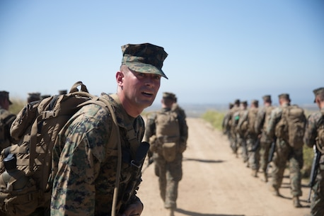 U.S. Marine Staff Sgt. David Powell, a landing support specialist with Combat Logistics Battalion 5, Combat Logistics Regiment 1, 1st Marine Logistics Group, observes the Marines to ensure no one falls behind on a six mile conditioning hike on Camp Pendleton, Calif., June 16, 2017. The Marines have four conditioning hikes to prepare for Mountain Exercise 4-17 which will be conducted on the Marine Corps Mountain Warfare Training Center in Bridgeport, Calif. (U.S. Marine Corps photo by Lance Cpl. Timothy Shoemaker)