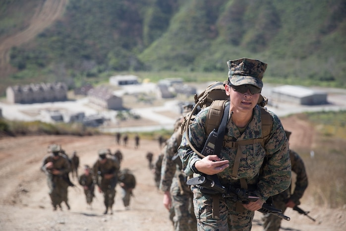 U.S. Marine Staff Sgt. Iris Marini, a supply admin training chief for Combat Logistics Battalion 5, Combat Logistics Regiment 1, 1st Marine Logistics Group participates in a six mile conditioning hike on Camp Pendleton, Calif., June 16, 2017. The Marines have four conditioning hikes to prepare for Mountain Exercise 4-17 which will be conducted on the Marine Corps Mountain Warfare Training Center in Bridgeport, Calif. (U.S. Marine Corps photo by Lance Cpl. Timothy Shoemaker)