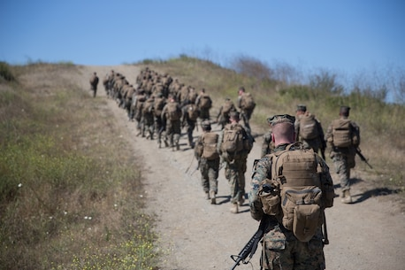 U.S. Marines with Combat Logistics Battalion 5, Combat Logistics Regiment 1, 1st Marine Logistics Group participate in a six mile conditioning hike on Camp Pendleton, Calif., June 16, 2017. The Marines have four conditioning hikes to prepare for Mountain Exercise 4-17 which will be conducted on the Marine Corps Mountain Warfare Training Center in Bridgeport, Calif. (U.S. Marine Corps photo by Lance Cpl. Timothy Shoemaker)
