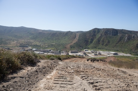 U.S. Marines with Combat Logistics Battalion 5, Combat Logistics Regiment 1, 1st Marine Logistics Group participate in a six mile conditioning hike on Camp Pendleton, Calif., June 16, 2017. There are four conditioning hikes prior to mountain exercise 4-17. The Marines have four conditioning hikes to prepare for Mountain Exercise 4-17 which will be conducted on the Marine Corps Mountain Warfare Training Center in Bridgeport, Calif. (U.S. Marine Corps photo by Lance Cpl. Timothy Shoemaker)
