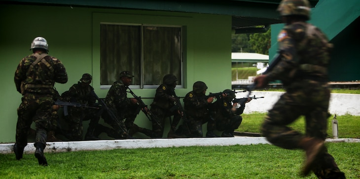 Trinidad and Tobago - Belize Defence Force soldiers take cover while conducting a simulated aerial and maritime raid during Exercise Tradewinds 2017 Phase II in Chaguaramas, Trinidad and Tobago, June 13, 2017. Tradewinds, an annual U.S. Southern Command-sponsored exercise, brings together 20 partner nations to increase Caribbean security and the combined ability to counter transnational terrorism and organize crime, and enhance humanitarian and disaster relief capabilities. (U.S. Marine Corps photo by Sgt. Olivia McDonald)