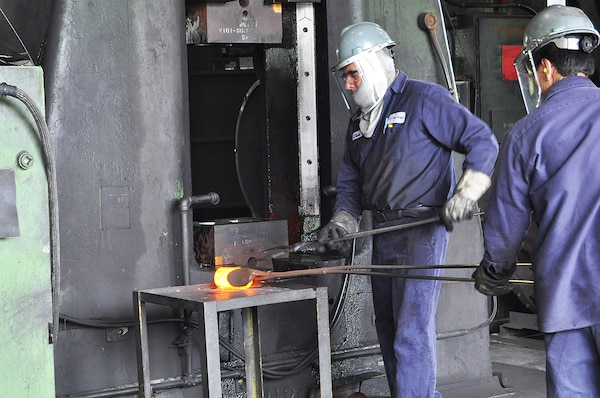 A foundry worker demonstrates forging a metal part during a two-day seminar for DLA Aviation Forging and Casting team members at the U.S. Drop Forge Co. in Woolwich Township, New Jersey.