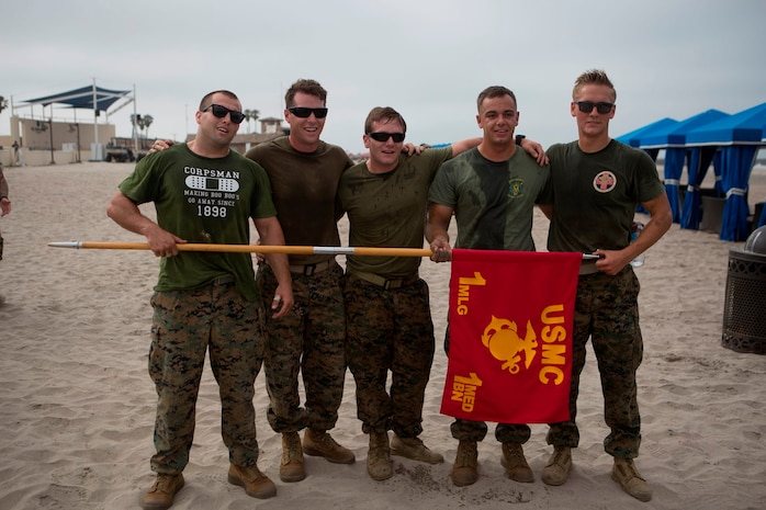 U.S. Navy (from left to right) Petty Officer Third Class John Jessie, Stefan Herrstrom, Jarrett Orich, Cody Carroll and Petty Officer Second Class Stephen Henderson, Corpsmen with 1st Medical Battalion, 1st Marine Logistics Group, pose with their unit guidon after completing the North County Corpsman Cup on Camp Pendleton, Calif., June 16, 2017. The North County Corpsman Cup is designed to test the knowledge, physical readiness and teamwork of each participating sailor while promoting esprit de corps among the Hospital Corpsman community. (U.S. Marine Corps photo by Lance Cpl. Joseph Sorci)