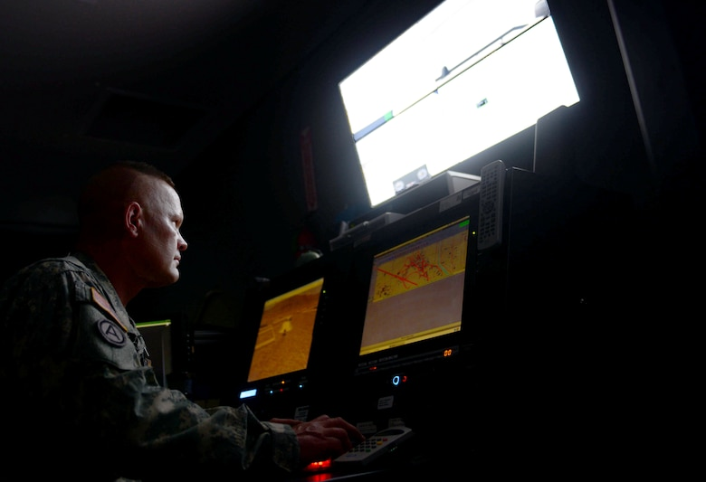 U.S. Army Staff Sgt. Mario Volmer, a range operator assigned to the South Dakota Army National Guard Training Center, programs obstacles for Ellsworth Airmen training in the virtual convoy at Camp Rapid, S.D., June 15, 2017. The virtual convoy is a multiple-station simulator that presents real-world convoy scenarios that Soldiers and Airmen may face overseas in contingency operations. (U.S. Air Force photo by Airman 1st Class Donald C. Knechtel)
