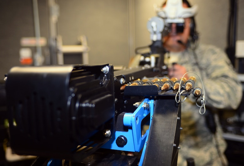 U.S. Air Force Tech. Sgt. Clint Lykken, the noncommissioned officer in charge of electrical operations assigned to the 28th Civil Engineer Squadron, Ellsworth Air Force Base, S.D., takes hold of the gunner position in the virtual convoy at Camp Rapid, S.D., June 15, 2017. Military personnel who deploy to contingency operations take advantage of the high-tech simulator to hone their convoy skills in a challenging but safe environment. (U.S. Air Force photo by Airman 1st Class Donald C. Knechtel)