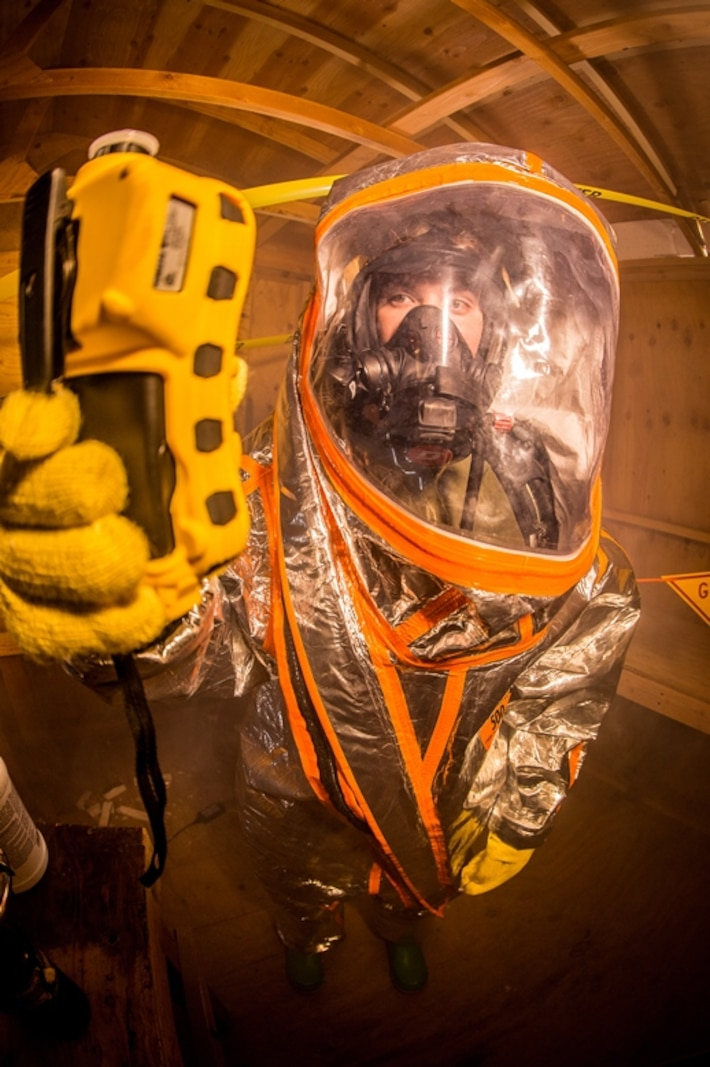 U.S. Marine Corps PFC. James Fish, a Chemical, Biological, Radiological and Nuclear Defense (CBRN) specialist with Headquarters Company, Headquarters Regiment, 1st Marine Logistics Group (MLG), conducts training in a Level A Vapor Protection suit during a Dismount Recon Sets Kit and Outfits (DRSKO) course on Camp Pendleton, Calif. June 13 2017. The training was hosted by the CBRN Marines form 1st MLG. The purpose of the training was to provide familiarization on the new DRSKO equipment to CBRN Marines from across 1 Marine Expeditionary Force. (U.S. Marine Corps photo by Gunnery Sgt. Evan Ahlin)