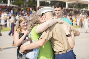 Glenda McCool, mother of Marine Corps Pfc. Sean G. McCool, kisses her son after he is dismissed by his senior drill instructor following graduation from training at Marine Corps Recruit Depot Parris Island, S.C., June 9, 2017. The seventh Marine in his family, McCool earned the distinction of being his platoon's honor graduate. Marine Corps photo by Lance Cpl. Joseph Jacob