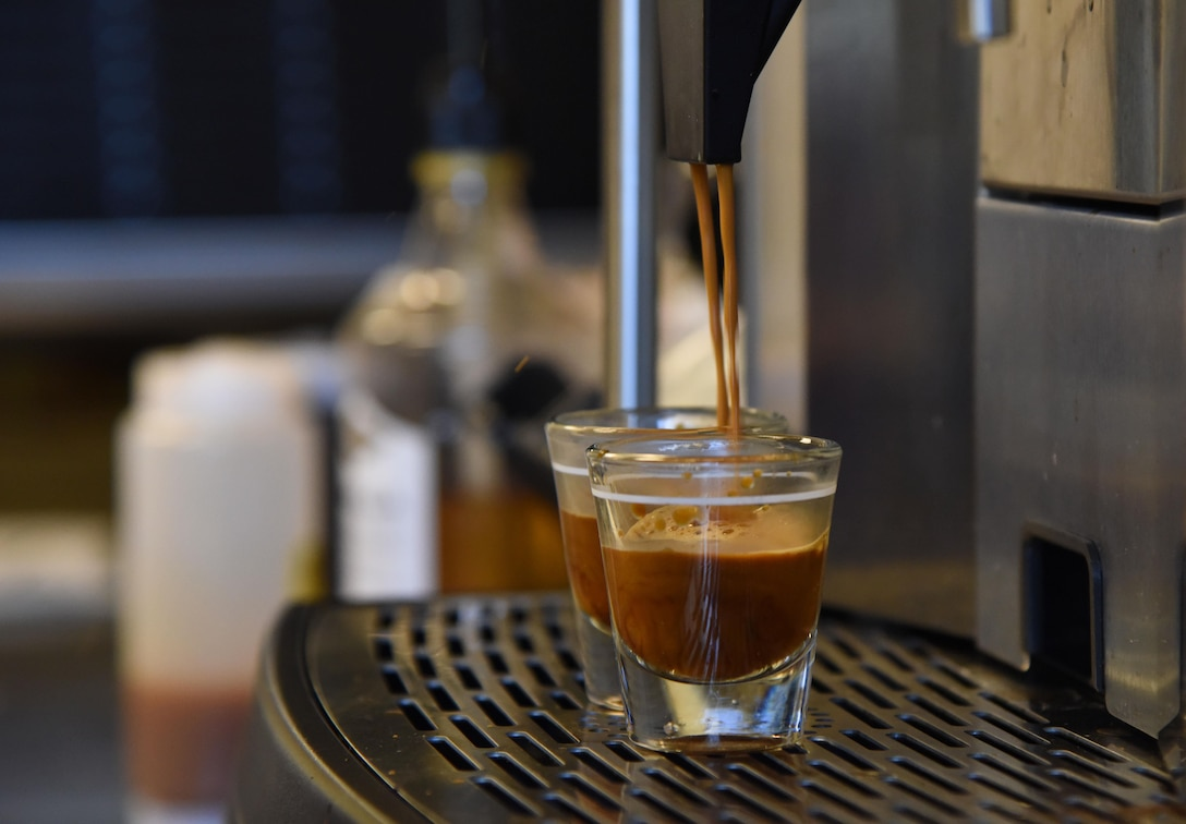 """Two shot glasses are filled with espresso at """"It Is In The Cup"""" in the Bay Breeze Event Center June 8, 2017, on Keesler Air Force Base, Miss. Keesler's new coffee & smoothie bar will have its grand opening on June 29 at the Bay Breeze Event Center. The facility proudly serves Starbucks coffee, Frappuccino's, iced beverages and espresso as well as Island Oasis smoothies in a variety of flavors. A full menu of items can be found at keesler81fss.us. (U.S. Air Force photo by Kemberly Groue)"""