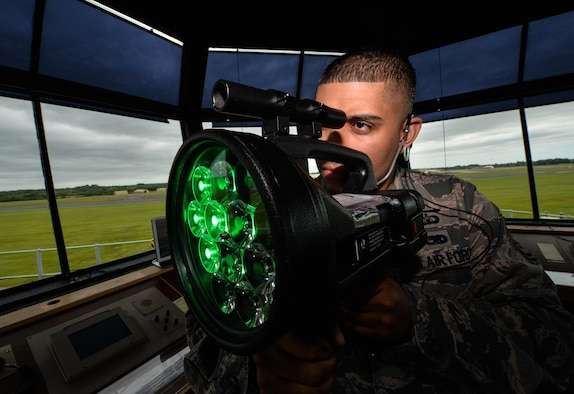 Tech. Sgt. Jason Medina, 5th Operations Support Squadron air traffic controller watch supervisor, operates a light gun at Royal Air Force Fairford, United Kingdom, June 10, 2017. A team of four air traffic controllers from across the globe assembled to work with seven different airframes in support of multi-national, large-scale exercises Arctic Challenge, BALTOPS 17 and Saber Strike 17. Allies and partner nations rely on common tactics, techniques, and procedures that enable them to quickly combine as an effective fighting force. Forces that participate in these exercise leave with a higher state of readiness, improved interoperability with forces from NATO and partner nations, and confidence in their ability to operate together in a time of crisis. (U.S. Air Force photo/Senior Airman Curt Beach)