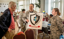 Lt. Col. Robert Vidoloff, 29th Intelligence Squadron commander, presents General Thomas S. Moorman, Jr. Retired, guest speaker, a drawing during the 29th Intelligence Squadron Heritage Day event, May 19, 2017 at Fort George G. Meade. During his speech, Moorman highlighted his time as an operations officer in the 432nd Reconnaissance Technical Squadron, which is a part of the 29th Intelligence Squadron lineage. (Courtesy photo)