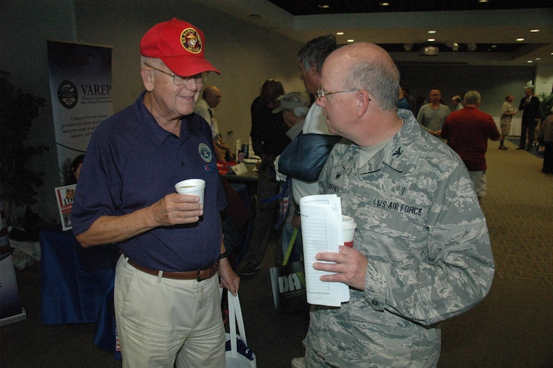 Col. (Dr.) Paul Hoerner, commander of the 61st Medical Squadron, chats with a retired Marine in the Gordon Conference Center during the annual Armed Forces Retiree Appreciation Day, held June 3, 2017 at Los Angeles Air Force Base in El Segundo, California. (U.S. Air Force photo/James Spellman, Jr.)