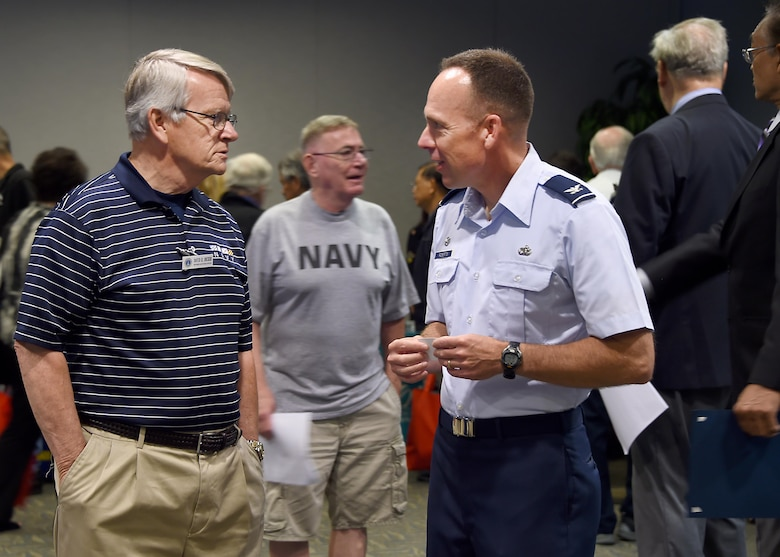 Col. Charles Roberts, commander of the 61st Air Base Group, chats with David Decker, a Navy veteran and volunteer with the Retiree Activities Office at Los Angeles Air Force Base during the annual Armed Forces Retiree Appreciation Day, held June 3, 2017. (U.S. Air Force photo/Joseph Juarez, Sr.)