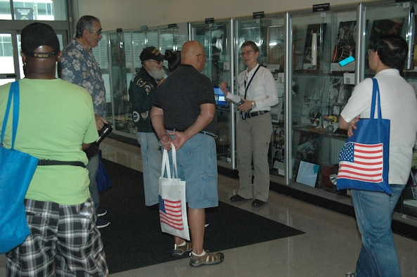 Karen Austin (center), Space and Missile Systems Center Historian, takes on the herculean task of leading three back-to-back tours of the SMC Missile Heritage Center for retirees and their guests during the annual Armed Forces Retiree Appreciation Day, June 3, 2017, at Los Angeles Air Force Base in El Segundo, California. (U.S. Air Force photo/ James Spellman, Jr.)