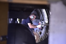 "DAYTON, Ohio (06/2017) -- Restoration Specialist Brian Lindamood works on the fuselage of the B-17F ""Memphis Belle""™ in the restoration hangar at the National Museum of the U.S. Air Force. The exhibit opening for this aircraft is planned for May 17, 2018.(U.S. Air Force photo by Ken LaRock)"
