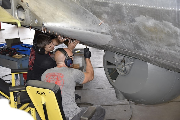 """DAYTON, Ohio (06/2017) -- (From left to right) Restoration Specialists Jason Davis and Chase Meredith work on the B-17F """"Memphis Belle""""™ in the restoration hangar at the National Museum of the U.S. Air Force. The exhibit opening for this aircraft is planned for May 17, 2018.(U.S. Air Force photo by Ken LaRock)"""
