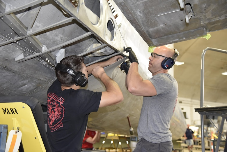 "DAYTON, Ohio (06/2017) -- (From left to right) Restoration Specialists Jason Davis and Chase Meredith work on the B-17F ""Memphis Belle""™ in the restoration hangar at the National Museum of the U.S. Air Force. The exhibit opening for this aircraft is planned for May 17, 2018.(U.S. Air Force photo by Ken LaRock)"