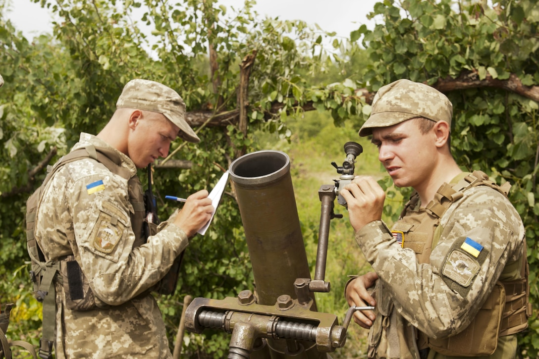 Ukrainian soldiers assigned to the 1st Airmobile Battalion, 79th Air Assault Brigade, adjust a mortar's trajectory during a live-fire exercise at the Yavoriv Combat Training Center  near Yavoriv, Ukraine, June 16, 2017. Army photo by Staff Sgt. Eric McDonough