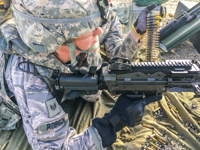 U.S. Staff Sgt. Amber Robison, with the 139th Security Forces Squadron, Missouri Air National Guard, prepares to fire a M249 light machine gun, during a live-fire training exercise at Fort Riley, Kan., June 7, 2017. The live-fire machine gun training is an annual requirement for members of security forces and support personnel. (U.S. Air National Guard photo by Staff Sgt. Troy Green)