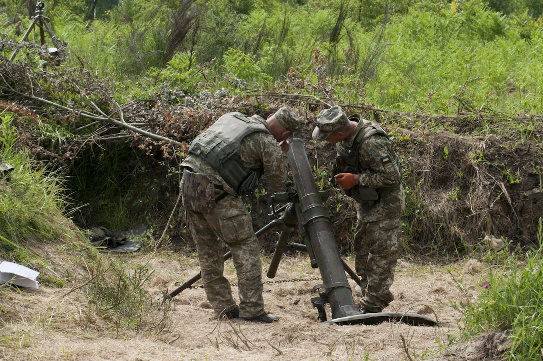 Ukrainian soldiers assigned to the 1st Airmobile Battalion, 79th Air Assault Brigade adjust a mortar's trajectory during a live-fire exercise at the Yavoriv Combat Training Center at the International Peacekeeping and Security Center, near Yavoriv, Ukraine, June 16, 2017. Yavoriv CTC staff, along with mentors from the Oklahoma Army National Guard's 45th Infantry Brigade Combat Team, led the training for soldiers from the 1-79th during the battalion's rotation through the Yavoriv CTC. The 45th is deployed to Ukraine as part of the Joint Multinational Training Group-Ukraine, an international coalition dedicated to improving the CTC's training capacity and building professionalism within the Ukrainian army. Army photo by Staff Sgt. Eric McDonough