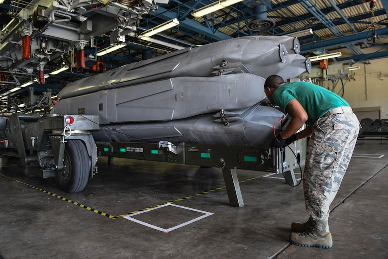 Senior Airman Terrance Jackson, assigned to the 2nd Munitions Squadron, guides a trailer around a missile rotator as part of a challenge in Air Force Global Strike Challenge on Barksdale Air Force Base, La., June 12, 2017. All four Airmen on the team were trained to do each of the tasks making the jobs interchangeable. (U.S. Air Force Photo/Airman 1st Class Sydney Bennett)
