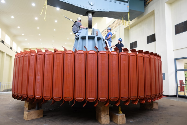 (Left to right) Kye Moss, A.J. Conley, and Dustin Woods, Voith Hydro work crew, prepare a 249-ton rotor before lifting and installing it in hydropower unit two at Center Hill Dam in Lancaster, Tenn., June 19, 2017. The U.S. Army Corps of Engineers Nashville District is rehabilitating the unit and expects to bring it online in late July after the completion of its assembly and load testing.