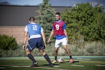 PETERSON AIR FORCE BASE, Colo. - Team Pete Airmen match up during a soccer game for Sports and Field Day, June 15, 2017, at Peterson Air Force Base, Colo. During the annual Sports and Field Day, Team Pete units compete for points based off the number of participants, volunteers and wins in the various sports and games held. (U.S. Air Force photo by Senior Airman Dennis Hoffman)