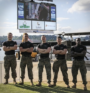 U.S. Marines with Recruiting Substation (RSS) Chattanooga and RSS West Georgia stand in front of a Marines advertisement during the Riverbend Festival in Chattanooga, Tennessee, June 11, 2017. Marines challenged Riverbend Festival attendees to do as many Marine Corps pull-ups as they could. (U.S. Marine Corps photo by Sgt. Mandaline Hatch)