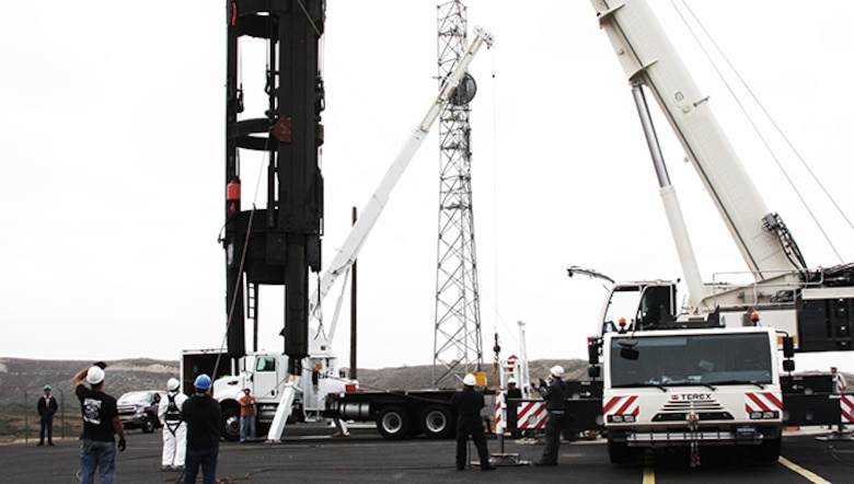 A Missile Suspension System is hoisted out of a silo to be refurbished. (Courtesy photo)