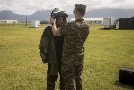 An Air Force Junior Reserve Officer Training Corps cadet dons an explosive ordnance disposal suit aboard Marine Corps Base Hawaii, June 15, 2017. The JROTC cadets were given a base tour to observe MCB Hawaii operations. (U.S. Marine Corps photo by Lance Cpl. Isabelo Tabanguil)