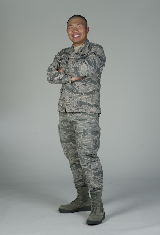 Airman Wang Zhe, 60th Comptroller Squadron, poses for a photo at Travis Air Force Base, Calif., June 20, 2017. Wang is from Kaifeng, China and joined the U.S. Air Force in September 2016. (U.S. Air Force Photo by Heide Couch)