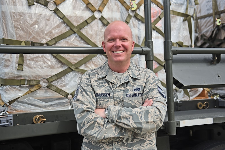 Technical Sgt. Jonathan Rasmussen, small air terminal section chief at Joint Task Force-Bravo, poses for a photograph as his day begins at Soto Cano Air Base, June 13, 2017. His call to duty includes supporting a weekly rotating mission in which a C130 aircraft brings in supplies such as food and medication from Charleston Air Force Base. These supplies go to the dining facility and other entities at JTF-Bravo to ensure that all service members' needs are covered.
