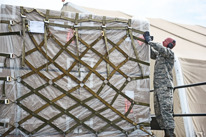 Technical Sgt. Jonathan Rasmussen, small air terminal section chief at Joint Task Force-Bravo, checks cargo that has been received at Soto Cano Air Base, June 13, 2017. His call to duty recently involved a KC-10 aircraft that arrived with humanitarian cargo and also 767 airplane that transported the Special Purpose Marine Air ground Task Force-Southern Command.