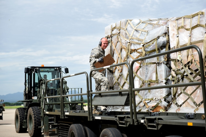 Technical Sgt. Jonathan Rasmussen, small air terminal section chief at Joint Task Force-Bravo, inspects cargo that has been received at Soto Cano Air Base, June 13, 2017. His call to duty includes supporting the Denton Cargo mission in which humanitarian supplies are sent to countries in need. His duties also support service member rotations as his team receives their cargo and new personnel upon arrival to Soto Cano Air Base.