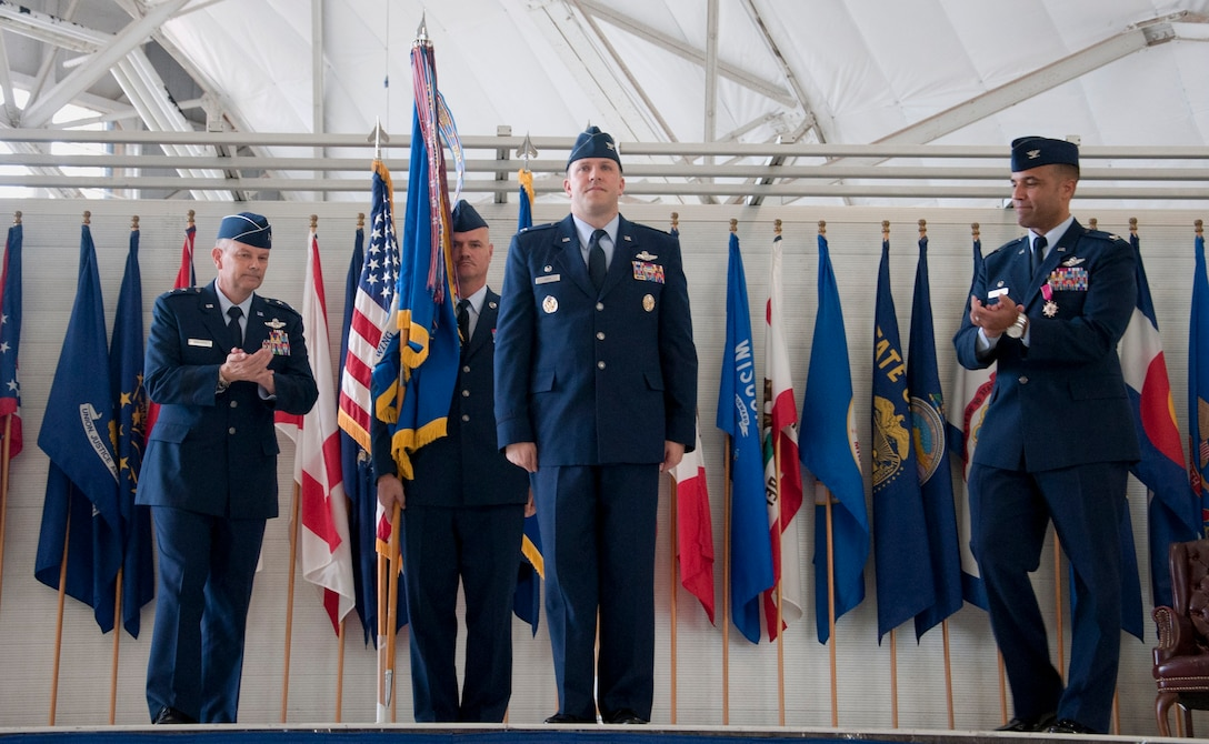 Maj. Gen. Glen VanHerck, Air Force Warfare Center commander (left) and Col. Adrian Spain, outgoing 53rd Wing commander (far right), congratulate Col. David Abba (center), the new 53rd Wing commander June 20 at Eglin Air Force Base, Fla.  Abba previously served here from Jan. 2004 through June 2006 as a member of the 58th Fighter Squadron, 33rd Fighter Wing. (U.S. Air Force courtesy photo/Master Sgt. Jamie Munn)