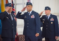 Maj. Gen. Glen VanHerck, Air Force Warfare Center commander, Col. Adrian Spain, outgoing 53rd Wing commander, and Col. David Abba, the new 53rd Wing commander, salute the Colors during the National Anthem June 20 at Eglin Air Force Base, Fla. Abba assumed command of the 53rd Wing from Spain during the ceremony. (U.S. Air Force photo/Ilka Cole)