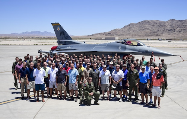 Current and former pilots from the United States Air Force Weapons School F-16 Fighting Falcon division pose for a group picture in front of an F-16 June 15, 2017, at Nellis Air Force Base,Nev. THe pilots celebrated the division's 35th Anniversary with a reunion of members from the first pilots in the division 35 years ago to pilots currently assigned to the 16th Weapons Squadron. (U.S. Air Force photo by Airman 1st Class Andrew D. Sarver/Released)