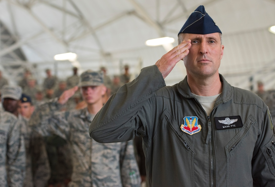 Col. Mark Pye, 53rd Wing vice commander, leads the formation of Airmen in salute of the new 53rd Wing Commander Col. David Abba, during a change of command ceremony June 20 at Eglin Air Force Base, Fla. The first salute rendered is a tradition to honor the new commander upon their assumption of the command. (U.S. Air Force photo/Ilka Cole)