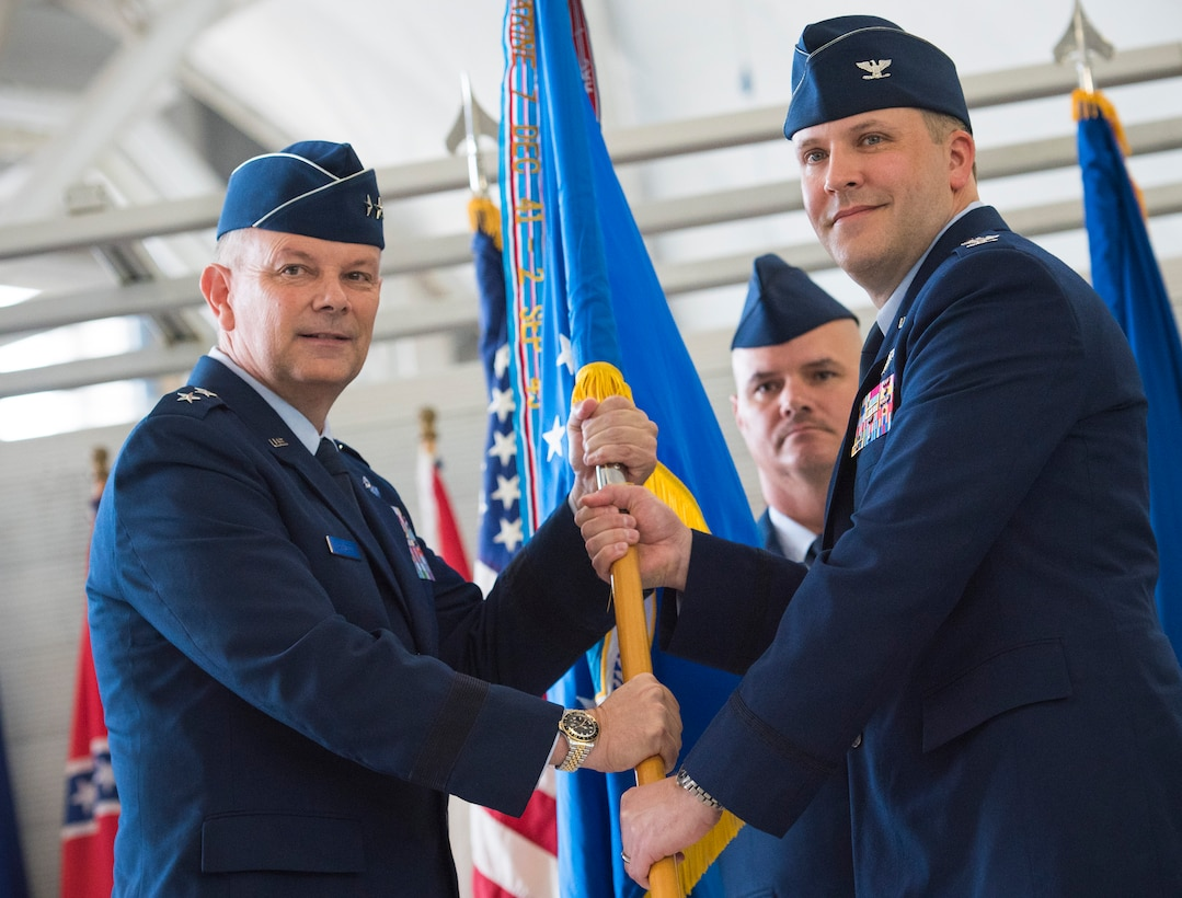 Col. David Abba accepts the 53rd Wing guidon from Maj. Gen. Glen VanHerck, Air Force Warfare Center commander, during a change of command ceremony June 20 at Eglin Air Force Base, Fla. The acceptance of the guidon signifies Abba's command of the wing. Prior to his current assignment, Abba commanded the 3rd Operations Group at Joint Base Elmendorf-Richardson, Alaska. (U.S. Air Force photo/Ilka Cole)