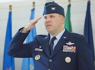 Col. David Abba, 53rd Wing commander, renders his first salute to the wing, during a change of command ceremony June 20 at Eglin Air Force Base, Fla.  Abba is a command pilot with more than 1,700 hours in the T-38A, F-15C, F-22A, E-3B/C, C-12F, C-17A. (U.S. Air Force photo/Ilka Cole)